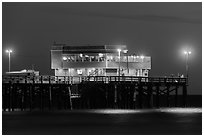 Newport Pier and restaurant at night. Newport Beach, Orange County, California, USA ( black and white)