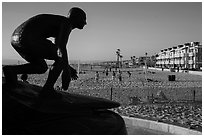 Statue of surfer and lifeguard Tim Kelly, Hermosa Beach. Los Angeles, California, USA ( black and white)
