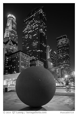 Spherical sculpture and skyscrappers at night, Pershing Square. Los Angeles, California, USA (black and white)