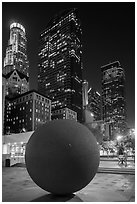 Spherical sculpture and skyscrappers at night, Pershing Square. Los Angeles, California, USA ( black and white)