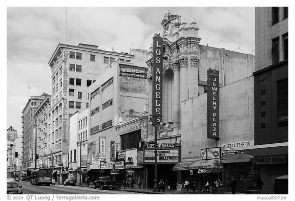 Downtown street with Los Angeles historic theater. Los Angeles, California, USA (black and white)