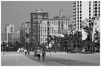 People exercising on beach promenade. Long Beach, Los Angeles, California, USA ( black and white)