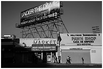 Street with liquor and pawn shops. Hollywood, Los Angeles, California, USA ( black and white)