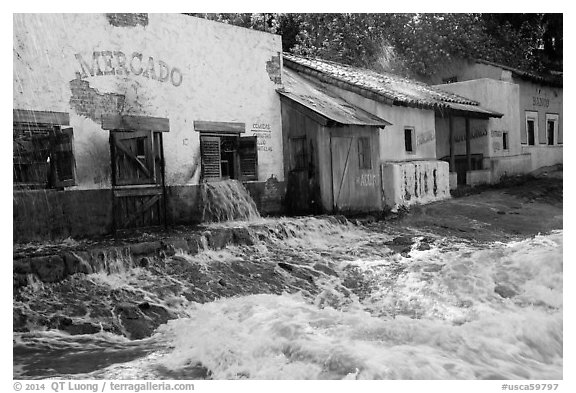 Adobe buildings and artificial flood, Universal Studios. Universal City, Los Angeles, California, USA (black and white)