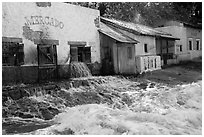 Adobe buildings and artificial flood, Universal Studios. Universal City, Los Angeles, California, USA ( black and white)