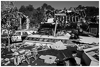 Movie set consisting of plane crash site, Universal Studios. Universal City, Los Angeles, California, USA ( black and white)