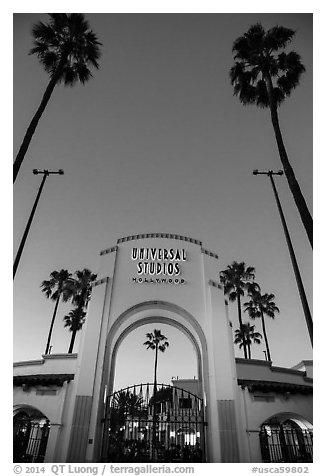Entrance gate at dusk, Universal Studios. Universal City, Los Angeles, California, USA (black and white)