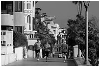 People exercising, beachfront promenade, Manhattan Beach. Los Angeles, California, USA ( black and white)