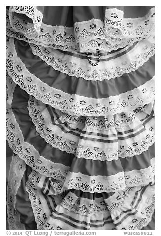Detail of dresses with Mexican colors, El Pueblo. Los Angeles, California, USA (black and white)