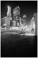 Fountain and high-rises at night, Pershing Square. Los Angeles, California, USA ( black and white)