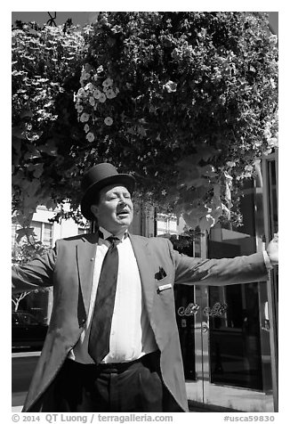 Man with red jacket, tie, and suit. Beverly Hills, Los Angeles, California, USA (black and white)