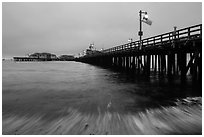 Pier and wave at dawn. Santa Barbara, California, USA ( black and white)