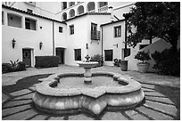 Historic Paseo courtyard and fountain. Santa Barbara, California, USA ( black and white)