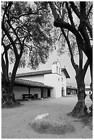 Chapel and Presidio seen through trees. Santa Barbara, California, USA ( black and white)