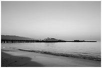 Beach and Stearns Wharff and sunset. Santa Barbara, California, USA ( black and white)