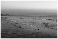 Beach at sunset, Malibu. Los Angeles, California, USA ( black and white)