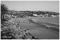 Beach with people strolling in late afternoon. Laguna Beach, Orange County, California, USA ( black and white)