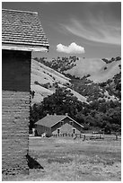 Barracks and hills, Fort Tejon state historic park. California, USA ( black and white)