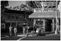 Visitors cross street in shopping area. Laguna Beach, Orange County, California, USA ( black and white)
