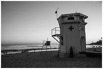 Beach and lifeguard tower at sunset. Laguna Beach, Orange County, California, USA ( black and white)