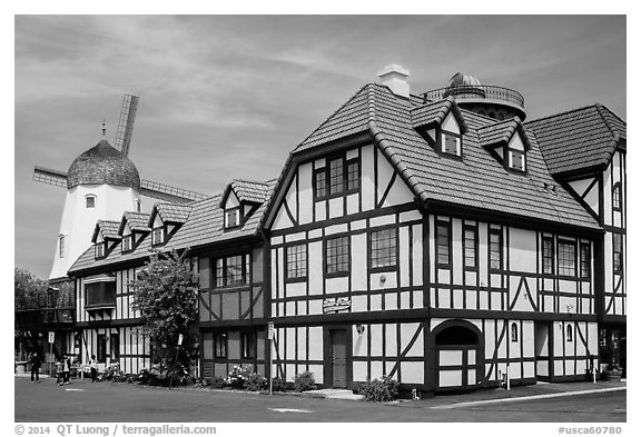 Half-timbered buildings and windmill. Solvang, California, USA (black and white)