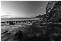 Creek, boulders, cliff, and ocean at dusk. Big Sur, California, USA ( black and white)