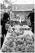 Customers buying fruit at stand. California, USA ( black and white)