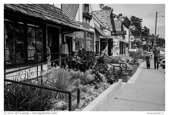 Shops and couple walking, Cambria. California, USA (black and white)