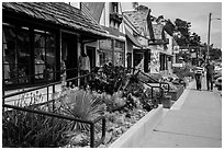 Shops and couple walking, Cambria. California, USA ( black and white)