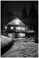 Cabin with window lights in winter. California, USA ( black and white)