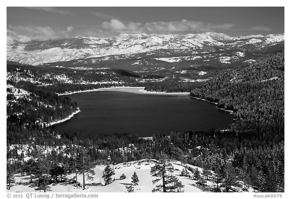 Donner Lake and snowy mountains in winter. California, USA (black and white)