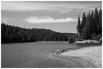 Family on shore of Jenkinson Lake, Pollock Pines. California, USA ( black and white)