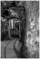 Gallery with tracks and ore car, Gold Bug Mine, Placerville. California, USA ( black and white)