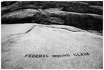 Federal Mining Claim painted on rocks, El Dorado County. California, USA ( black and white)