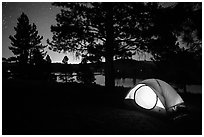 Tent and Prosser Reservoir at night, Tahoe National Forest. California, USA ( black and white)