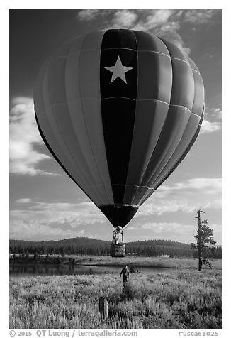 Hot air balloon low next to Prosser Reservoir, Tahoe National Forest. California, USA (black and white)