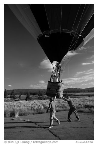Helpers pull hot air balloon, Tahoe National Forest. California, USA (black and white)