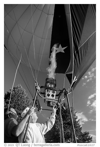 Pilot releases hot air into balloon, Tahoe National Forest. California, USA (black and white)