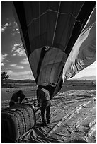 Crew pulling down hot air ballon, Tahoe National Forest. California, USA ( black and white)