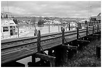 Railroad tresle and Petaluma River and Yacht Club. Petaluma, California, USA ( black and white)