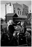 Makeup artist working on the street. Petaluma, California, USA ( black and white)
