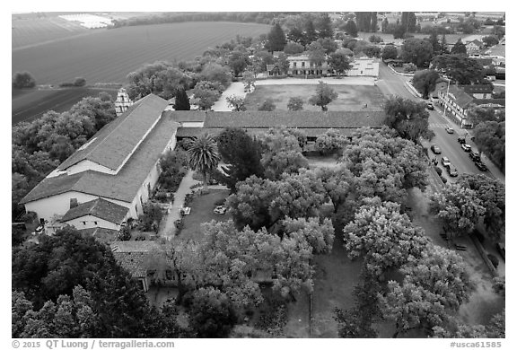Aerial view of Mission San Juan courtyard and San Juan Bautista State Historic Park. San Juan Bautista, California, USA (black and white)