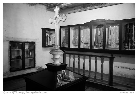 Room with cross and ceremonial dress, Mission San Juan. San Juan Bautista, California, USA (black and white)