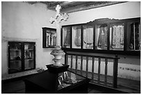Room with cross and ceremonial dress, Mission San Juan. San Juan Bautista, California, USA ( black and white)