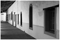 Brightly colored windows, inside arcade, Mission San Miguel. California, USA ( black and white)