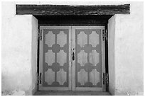 Decorated wooden door, Mission San Miguel. California, USA ( black and white)