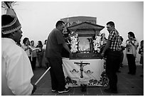Men carrying Senor de los Milagros altar, Mission San Miguel. California, USA ( black and white)