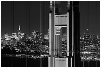 Golden Gate Bridge pillar and San Francisco skyline at night. San Francisco, California, USA ( black and white)