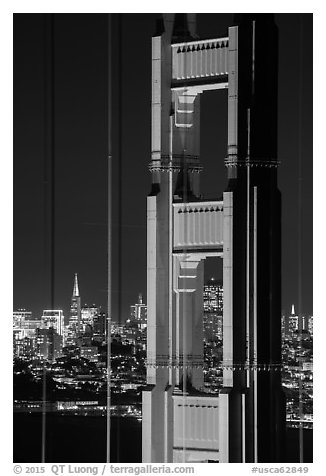 Golden Gate Bridge pillar and city skyline at night. San Francisco, California, USA (black and white)