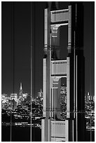 Golden Gate Bridge pillar and city skyline at night. San Francisco, California, USA ( black and white)